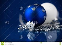 silver white and blue christmas ornaments on dark blue background