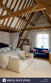 exposed beams in loft bedroom english 17th century manor house