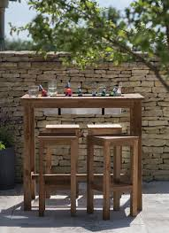 the perfect outdoor bar table with built in drinks cooler planter