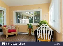 sunroom interior stock photos sunroom interior stock images alamy interior of sunroom addition to home and decor including small table with chairs and view of