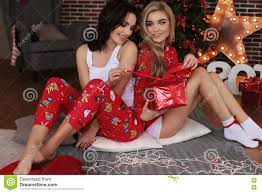 beautiful girls in cozy home clothes celebrating new year holida beautiful