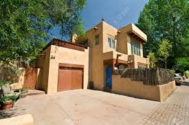 wide angle shot of modern adobe home in santa fe new mexico stock