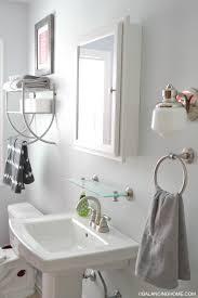 shelf above bathroom sink over the sink shelves bathroom sink ideas