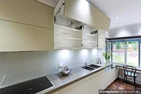 A Simple Sleek And Streamlined Designer Kitchen Completehome - Bifold kitchen cabinet doors