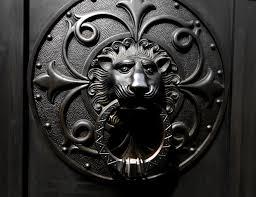metal lion sculpture black steel lion door knocker free image peakpx