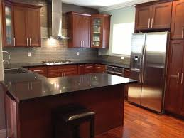 what backsplash looks with cherry cabinets grey glass subway tile backsplash with cherry cabinets and