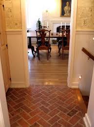 great white wall painted also faux brick herringbone tile floor as