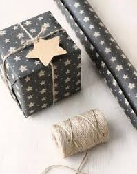 black gift wrapping paper roll today from homey oh my is back at it with a festive diy
