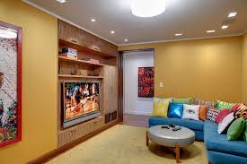 yellow wall color with blue sectional sofa using colorful toss