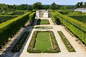 the french gardens of the petit trianon palace of versailles