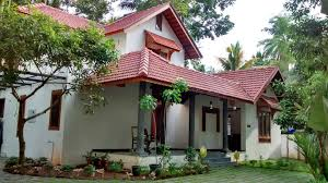 traditional kerala style residence designed around an existing