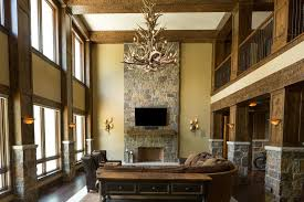 Chandelier Restoration Rustic Living Room With Cathedral Ceiling By Schill Architecture