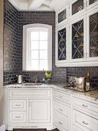 white kitchen cabinets with black subway tile backsplash black subway tile backsplash transitional kitchen bhg