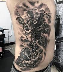 saint micheals tattoos on men on side of ribs art tattoos
