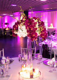 tall white and fuchsia centerpiece of white hydrangea and