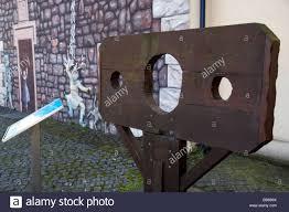 reproduction of carrickfergus stocks in front of wall mural reproduction of carrickfergus stocks in front of wall mural depicting a medieval or middle ages street scene carrickfergus