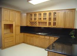 How To Clean Wood Kitchen Cabinets by Kitchen Vintage White Wooden Kitchen Cabinet With Brick Walls