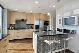 Granite Island Kitchen Kitchen In Contemporary Condo With Granite Island Stock Photo