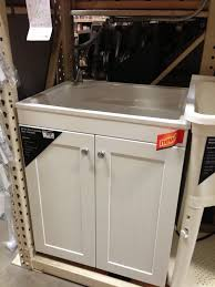 Laundry Utility Sink With Cabinet by Add All In One Laundry Sink Cabinet Next To Stacked Front Loaders