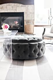 coffee table round upholstered tufted ottoman tucked under acrylic