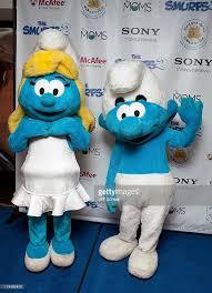 smurfette clumsy smurf attend smurfs 2 blue carpet chicago picture id174498473