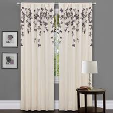 white fabric curtain with blue floral and leaves on black hook of
