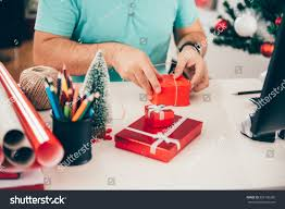 man sitting office desk wrapping christmas stock photo 529136206
