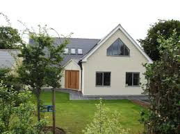 bungalow extension and raised roof accommodating upstairs bedroom