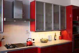 minimalist modern red wall kitchen with white cabinet on the white