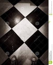 Download Black And White Floor by Feet On Black And White Tile Stock Photo Image 52492704