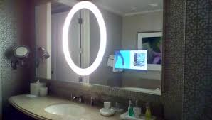 tv in the bathroom mirror lighted mirror and tv inside the bathroom mirror rm28632 picture