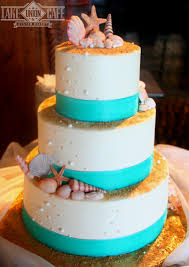 a fun all buttercream wedding cake done with a beach theme all