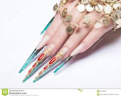long beautiful manicure on the fingers of turquoise and red nails