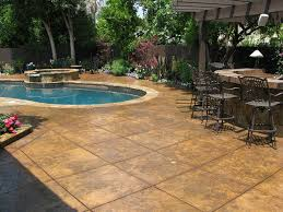 stamped concrete swimming pool landscape design outdoor spaces