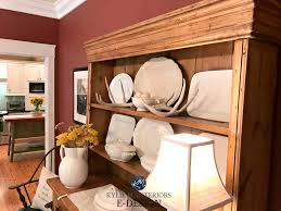 dining room buffet and hutch with white dishes onondaga clay red