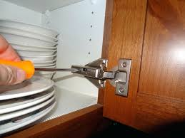 how to keep cabinet doors closed how to adjust kitchen cabinet doors that won t close to fix a