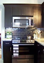 White Subway Tile With Glass Accent Backsplash Our House - Black glass subway tile backsplash