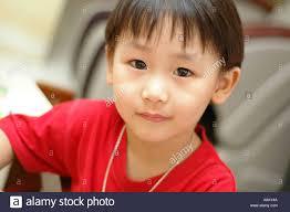 5 year asian boy wearing a t shirt stock photo