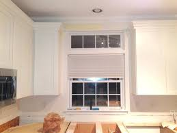 white kitchen cabinets with window trim can cabinet crown molding overlap window trim