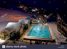 swimming pool at night in les m nuires north alps mountains