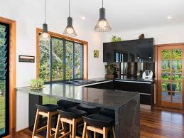warm wood traditional kitchen green marble pattern countertop