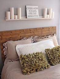 simple shelf on plain wall paint above wooden headboard for cheap