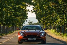 orange aston martin aston martin db11 shines in tuscany