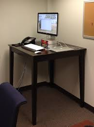 Standing Bar Table Standing Desks In The Workplace Technews