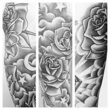 grey ink rose flower stars and clouds tattoo design