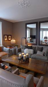 Living Room With Grey Walls by Warm And Cozy Living Room In Taupe With A Touch Of Orange