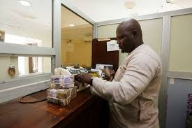 bureau de change nigeria imf presses nigeria to devalue naira currency daily mail