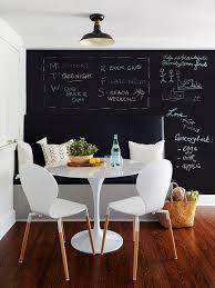 black dining bench on black wall transitional dining room