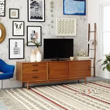 retro living room ideas a gallery wall and a mid century media console make for the