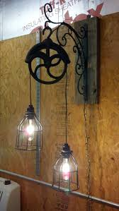 Log Cabin Lighting Fixtures Light Fixture Made From Pulley Pulleys So Practical And